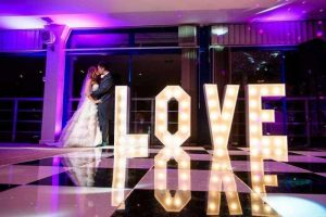 Giant Love letters on dance floor with bride and groom