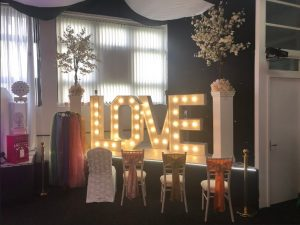 Light up giant love letters with chairs and decor