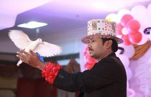 Magician performing dove trick