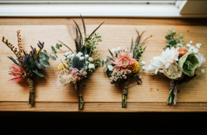 Delicate boutonnieres for a spring wedding