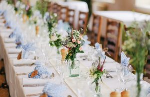 Spring wedding reception table with pastel accents