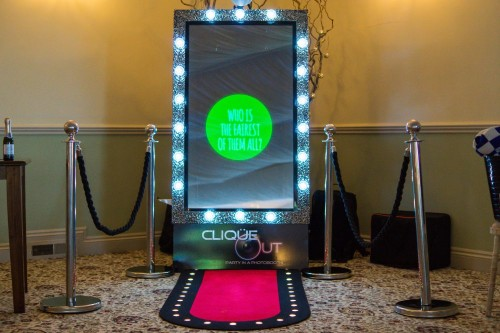 Selfie mirror photo booth with lights, red carpet and barriers